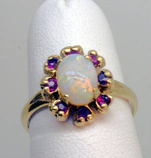 Opal surrounded by Rubies, gold ring # 3207