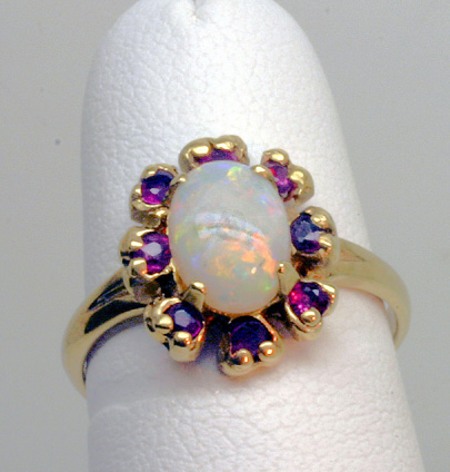 Gold Ring, Opal surrounded by Rubies, # 3207