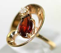 "14K gold ring with garnet+dia ""In the Air"""