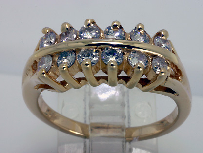 gold ring with 12 diamonds set in 2 rows.