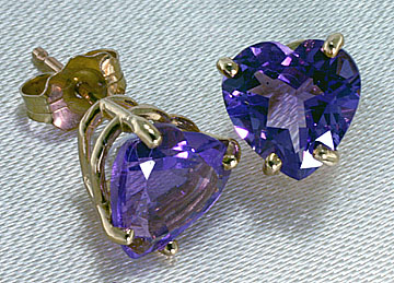 14 K gold post earrings set with Amethyst Hearts